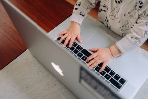 A baby types on a keyboard. This reflects concepts discussed in online therapy in Colorado with North Boulder Counseling 80301.
