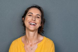 happy woman after trauma therapy and EMDR in boulder, co at north boulder counseling 80301