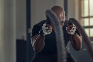 strong black man working out at the gym copes with PTSD symptoms and gets trauma therapy in Boulder, CO at North Boulder Counseling 80301