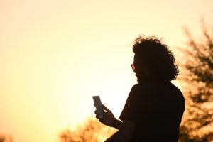 A picture of a person in front of the sunset is shown. This represents a person listening to a meditation. In addition to helping with worry, our therapists offer perinatal counseling, coparenting support, trauma therapy and so much more in Boulder, CO.