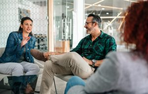 A group of people sit in business coaching in Boulder, CO together. They are satisfied with their business coach in Boulder, CO with North Boulder Counseling.