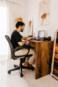 A man types on a laptop. He is starting online therapy in Colorado with North Boulder Counseling. 80301