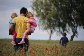 Photo of a parent with children in a Colorado flower field.