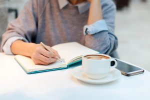 A person is writing. This demonstrates growth that can take place in therapy in Boulder, CO. Our counseling practice offers many services for counseling in Boulder, CO. And, our online therapists and counselor are experienced.