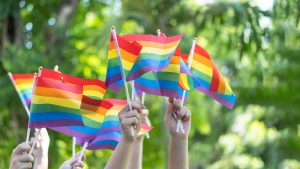 Pride flags waving outdoors representing being an LGBTQ ally. Learn more about allyship from boulder theapists who offer LGBTQ counseling in boulder, co