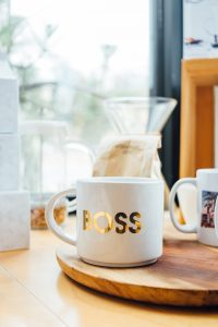 """A mug with the word """"boss"""" on the side rests on a breakfast table at North Boulder Counseling. Contact a business coach to learn more about business coaching for therapists in Fort Collins, CO. Private practice business coaching can help your practice thrive!"""